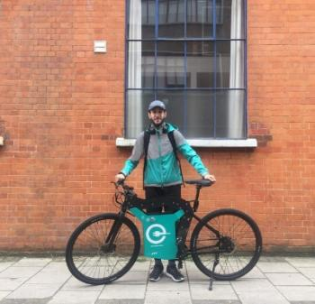Deliveroo rider with electric bike