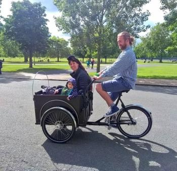 People being transported in a Cargo Bike