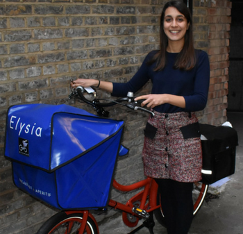 Lady stands holding cargo bike